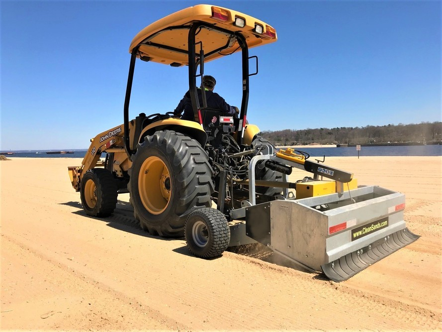Example of Beach Cleaner tractor attached from CleanSands, Inc.